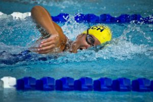 Female swimmer racing