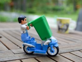 Toy bike with recycling bin