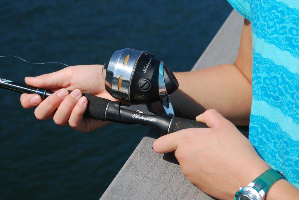 Girl Holding Fishing Pole