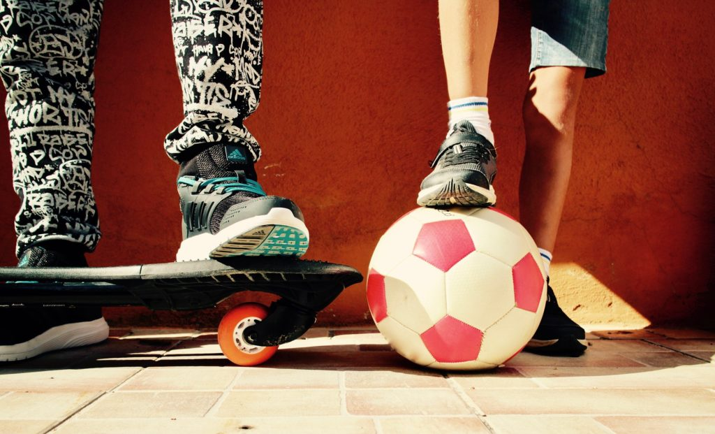 Skateboard and soccer ball