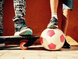 Skateboard and soccer ball